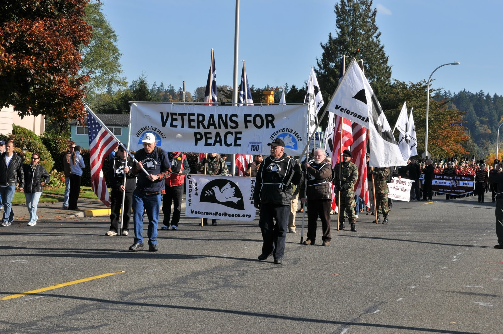 Photo of veterans for peace marching linking to an article about Veterans For Peace Sues to March in Veterans Day Parade
