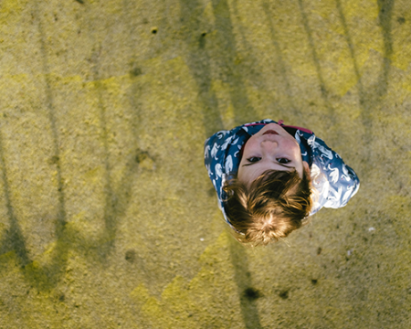 Photo of a child looking up