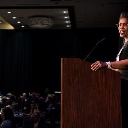 Photo of ACLU of Washington Deputy Director Michele Storms at the podium