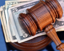 Photo of a gavel and money