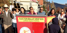 Photo of voters in front of a ballot box in Yakima